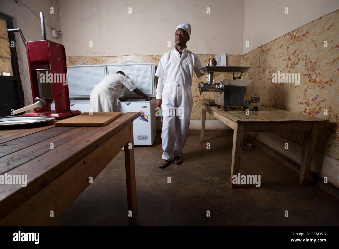 Entrepreneurial butcher poses in his meat processing room, Kigali, Rwanda - Stock Image
