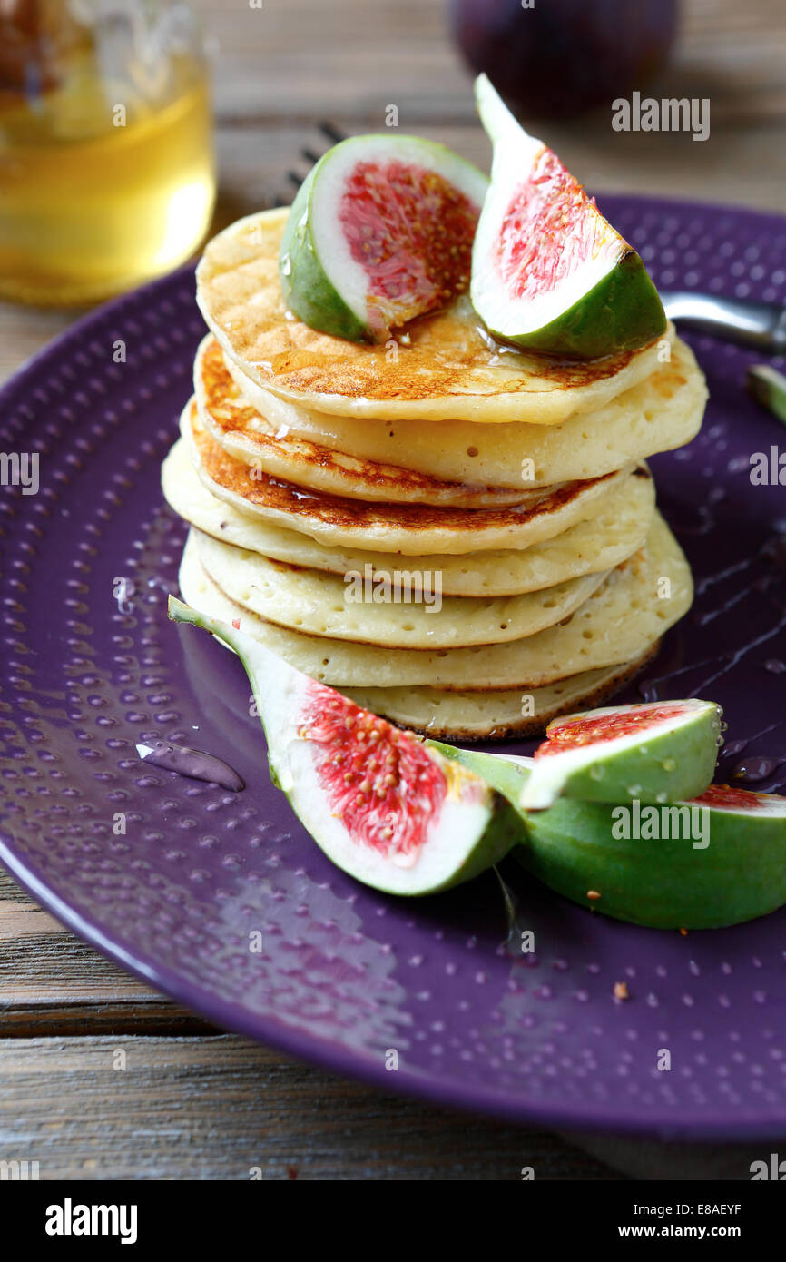 Pancakes with figs, food close up - Stock Image