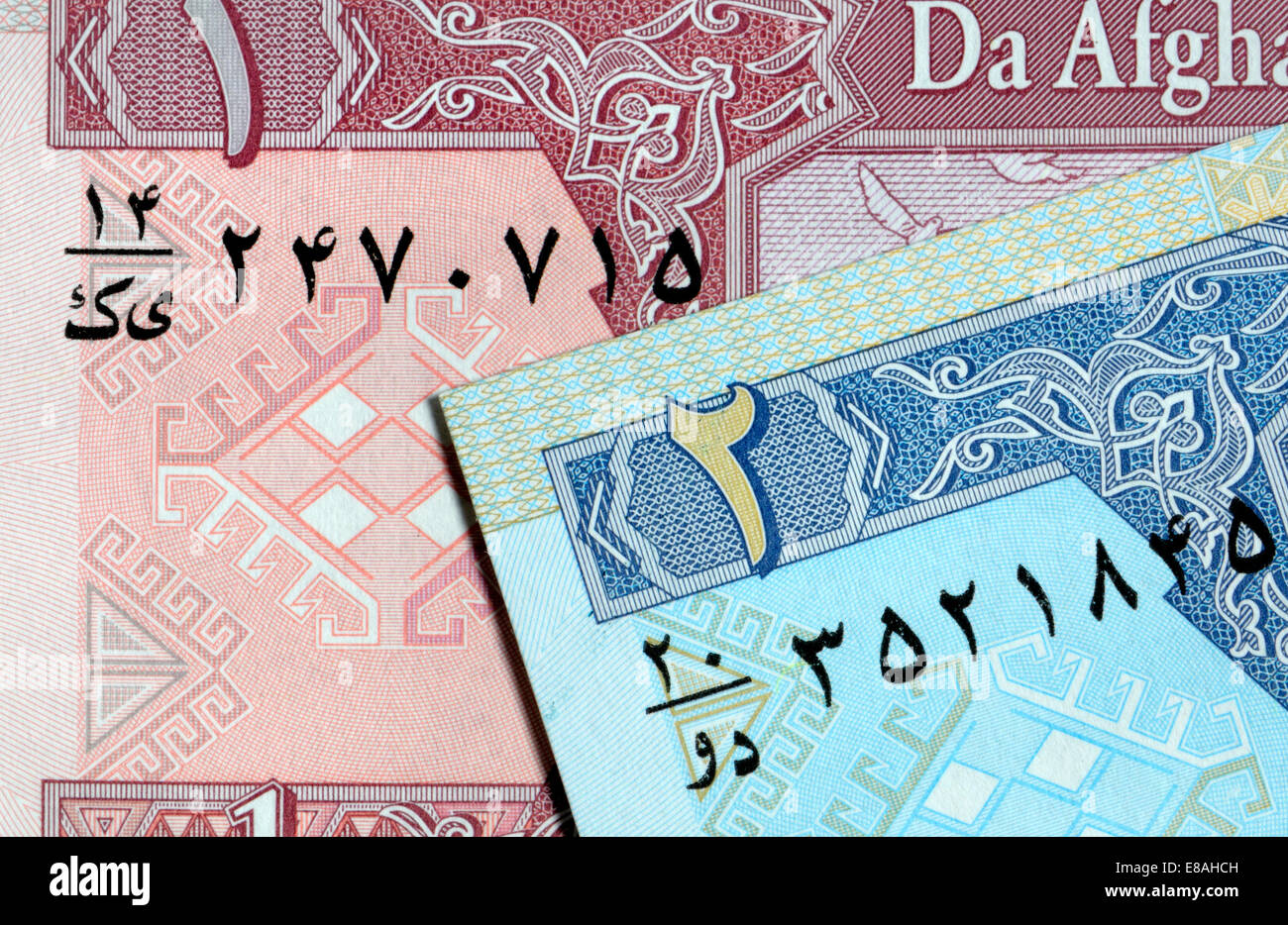 Detail from an Afghan banknote showing Arabic script and numerals - Stock Image