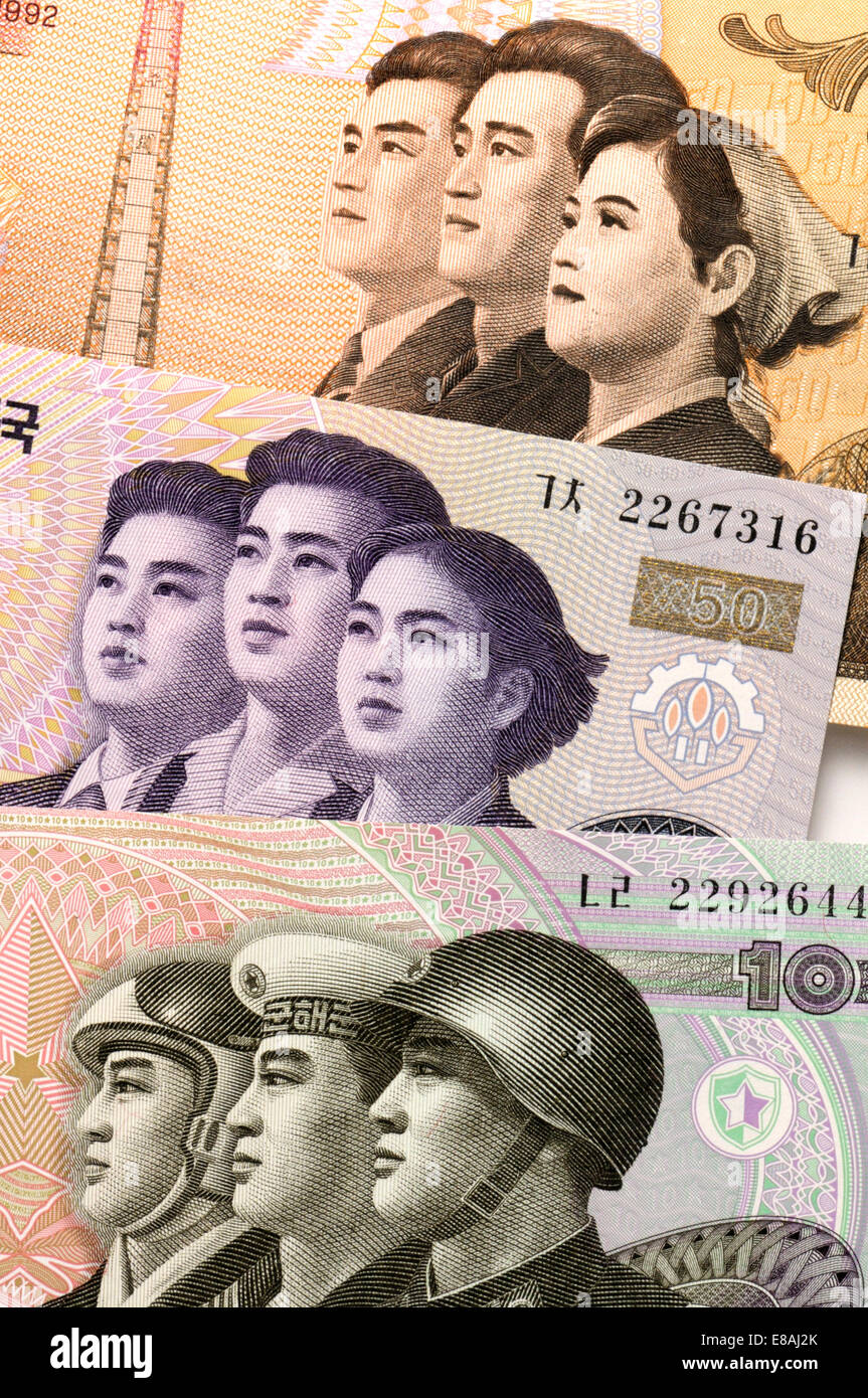 Details of North Korean banknote showing workers, students and armed forces - Stock Image