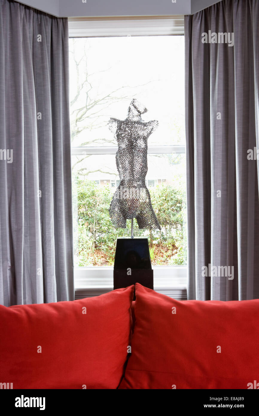 Surprising Mesh Figurative Sculpture In Front Of Living Room Window Download Free Architecture Designs Scobabritishbridgeorg