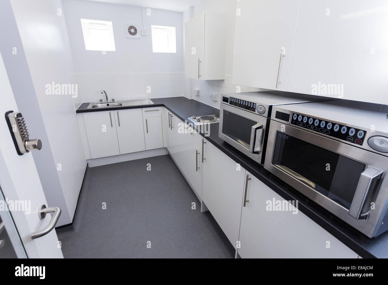 Small communal kitchenette. - Stock Image