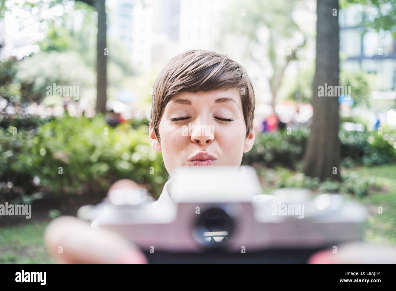 Photographer pouting for selfie - Stock Image