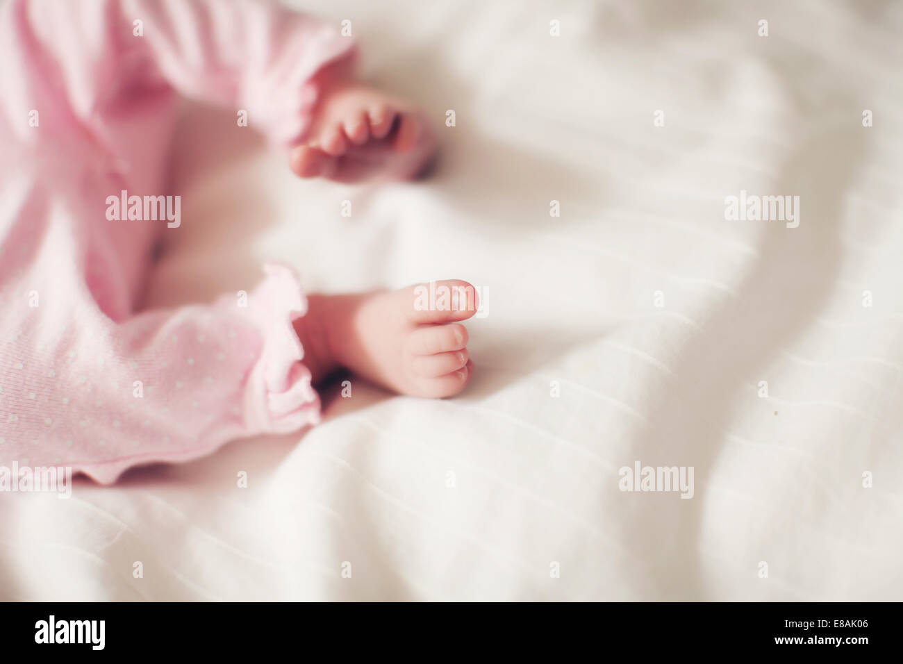 Baby girl's legs - Stock Image