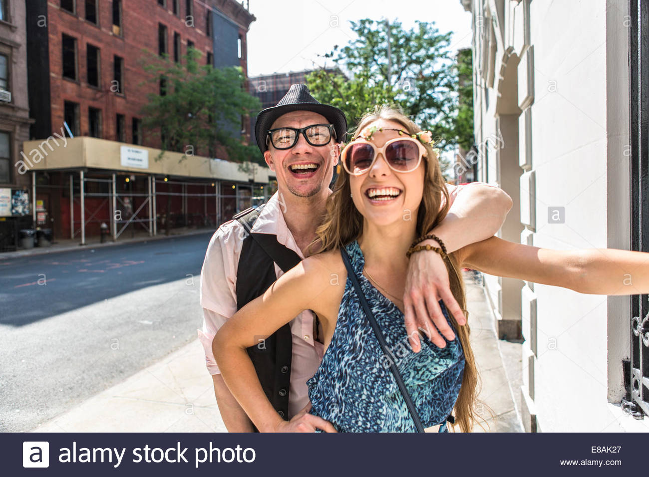 Funky couple in street, New York City, US - Stock Image