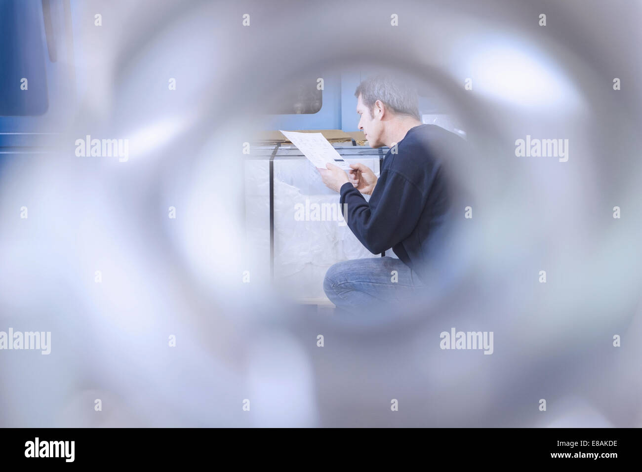 Engineer working in CNC precision engineering - Stock Image