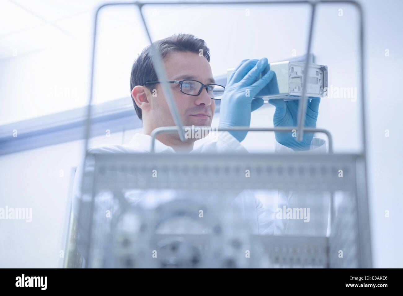 Engineer working in CNC engineering, production and quality control - Stock Image