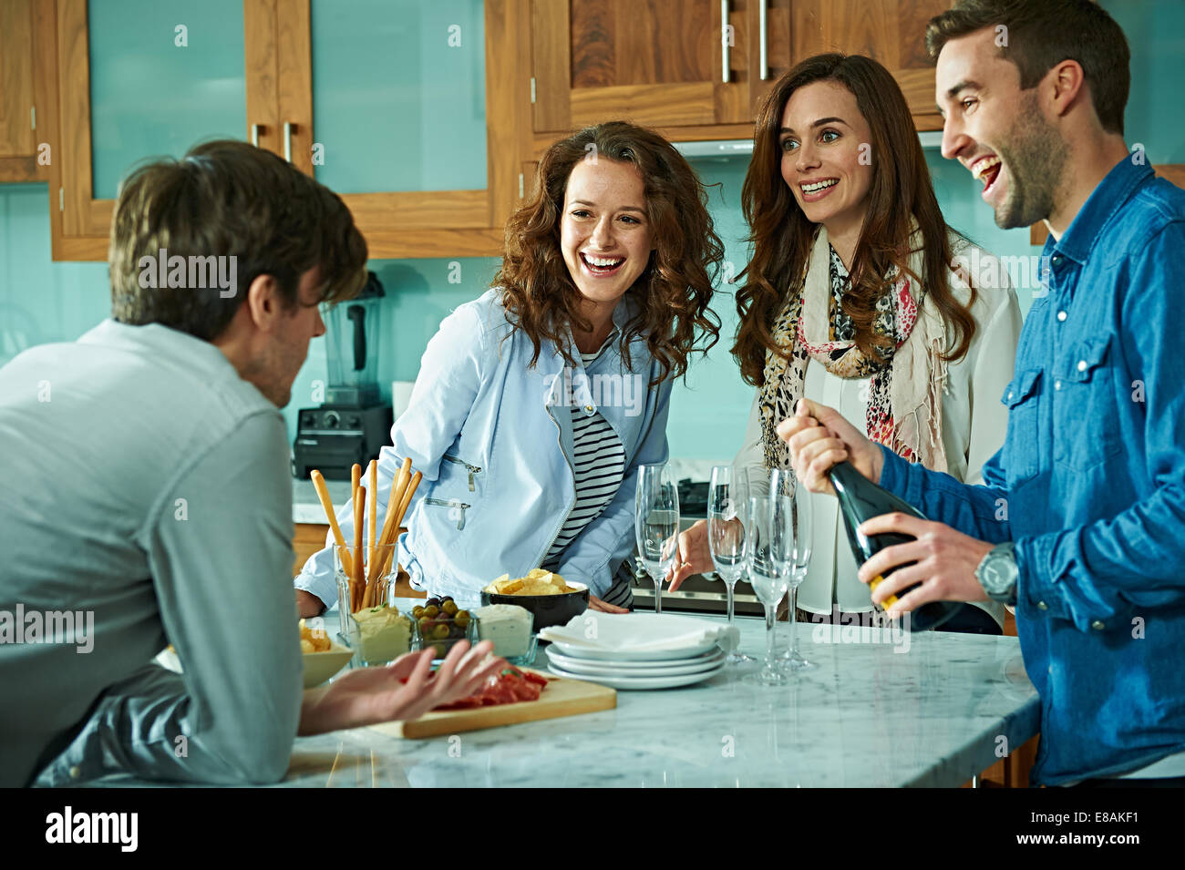 Friends celebrating at home - Stock Image