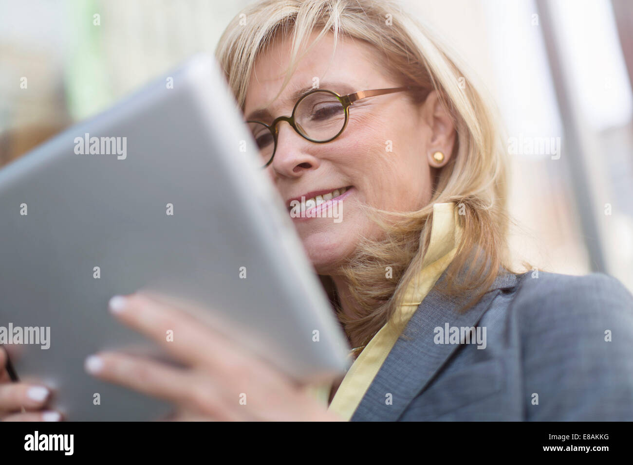 Mature businesswoman using digital tablet - Stock Image