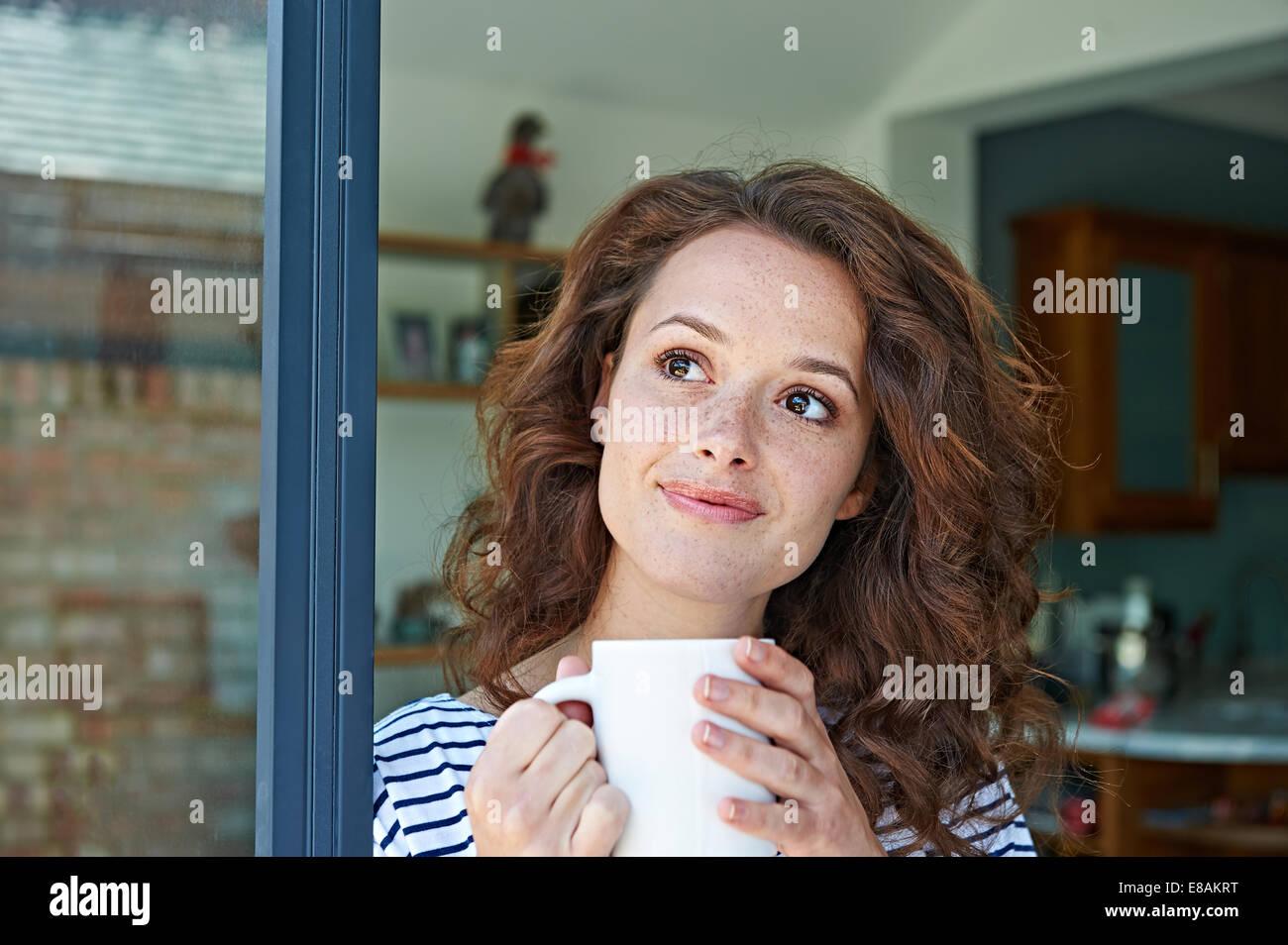 Close up of woman with mug - Stock Image