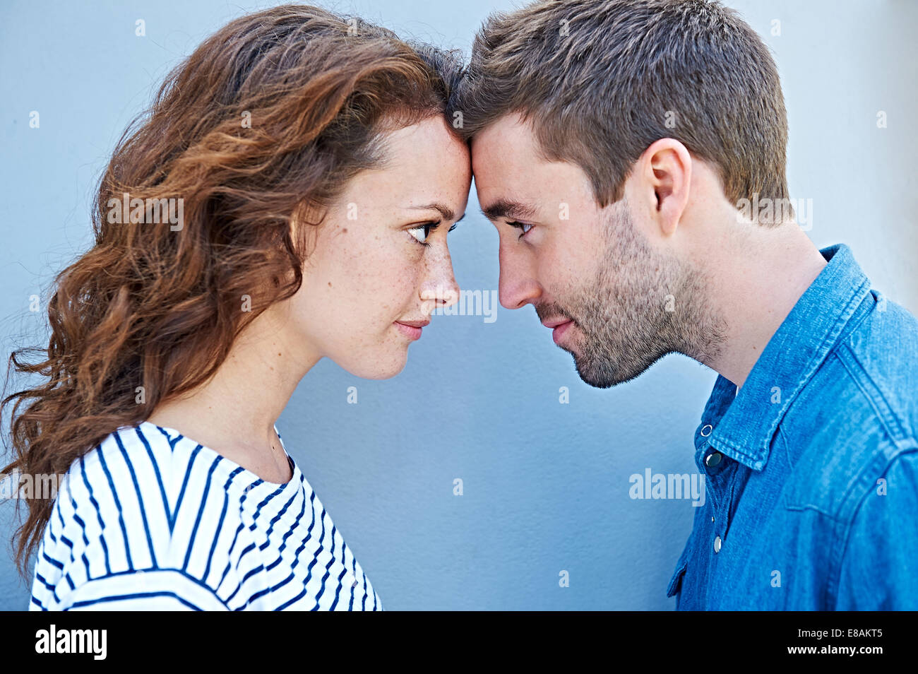Close up of couple forehead to forehead - Stock Image