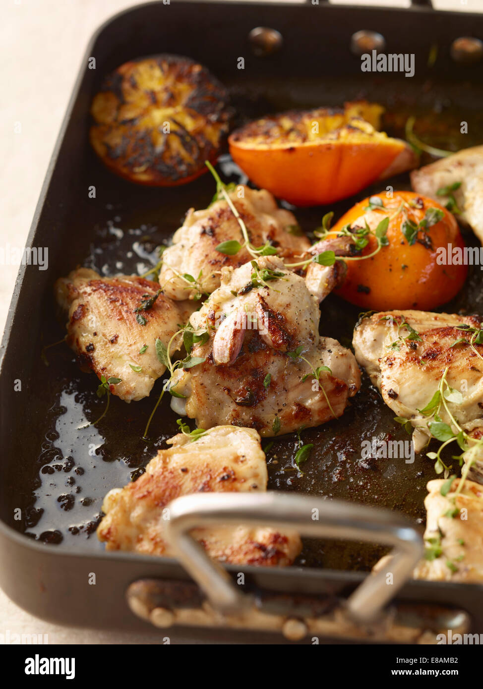 Rustic roasted garlic chicken with orange and thyme - Stock Image