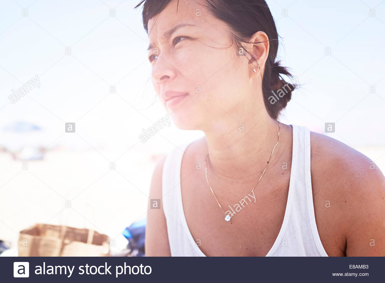 Close up candid portrait of mid adult woman - Stock Image