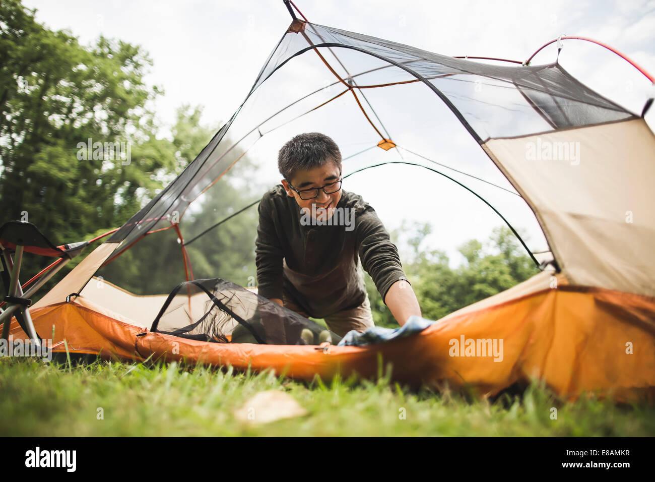 Mature man camping - Stock Image