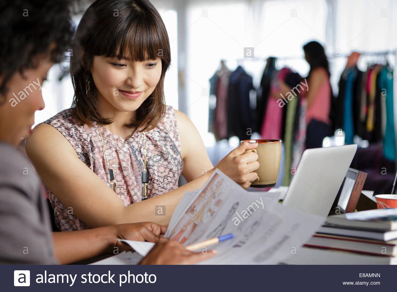 Female designers discussing designs - Stock Image