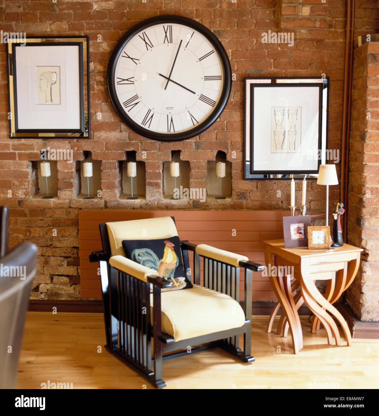 Edwardian Style Chair And Modern Nest Of Tables In Living Room With  Oversize Clock On Brick Wall With Small Alcoves