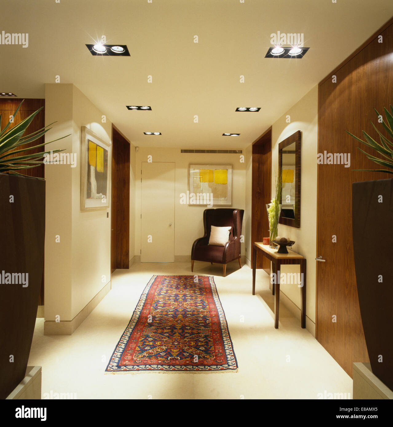 oriental rug on carpet. Oriental Rug On Cream Carpet In Modern Apartment Hall With Brown Leather Wing Chair R