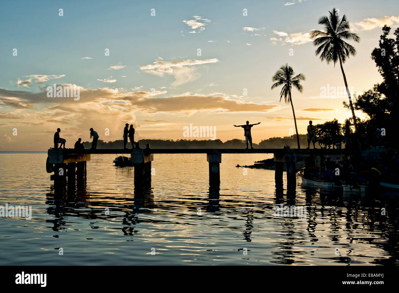 People on jetty, Roviana Lagoon, Munda, New Britain, Solomon Islands - Stock Image