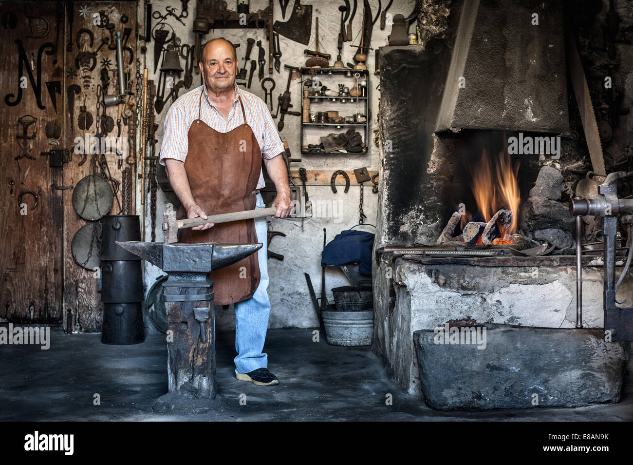 Portrait of senior male blacksmith in traditional workshop, Cagliari, Sardinia, Italy - Stock Image