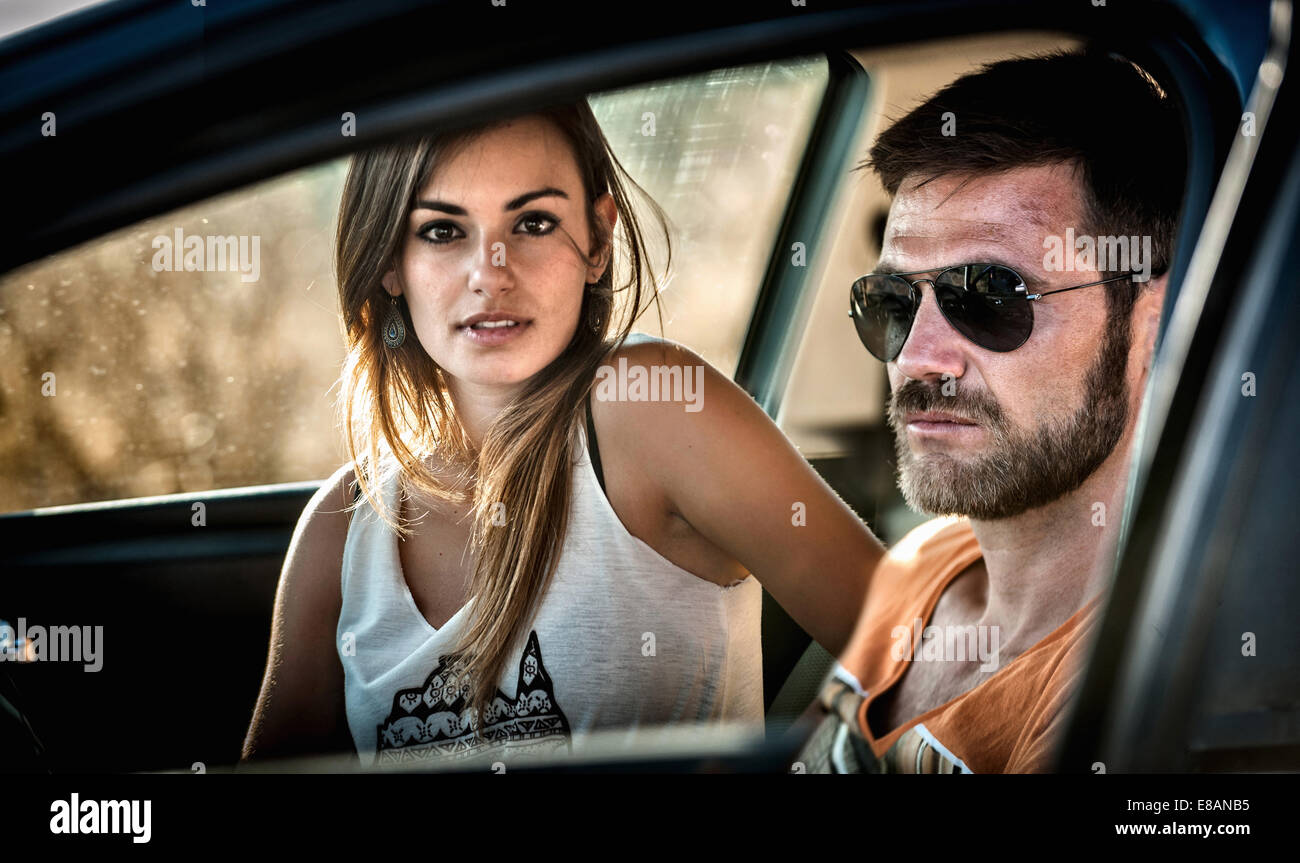 Close up of young couple through car window - Stock Image