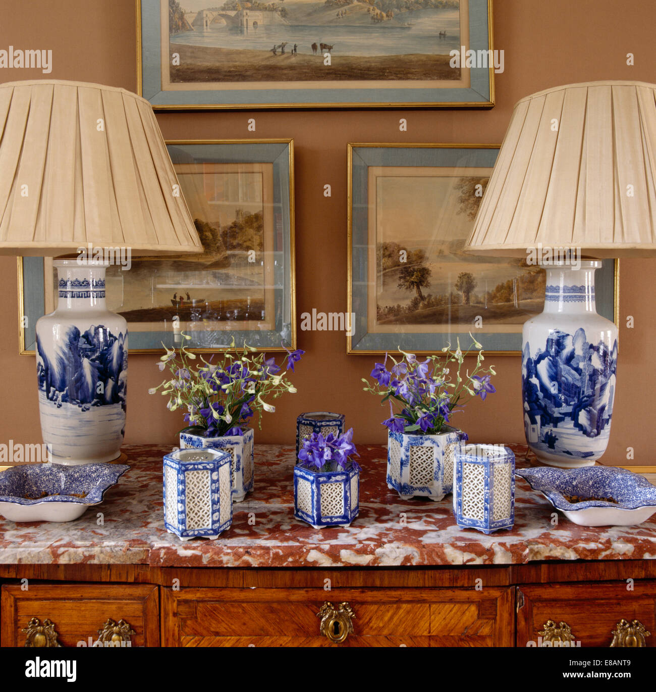 Close Up Of Bluewhite Ceramic Lamps On Chest Of Drawers With Stock