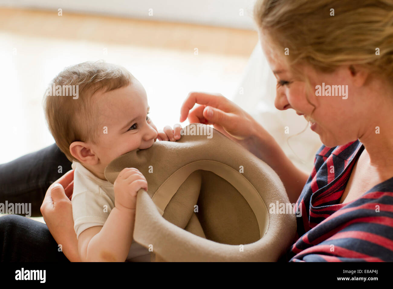 Mother playing with baby boy - Stock Image