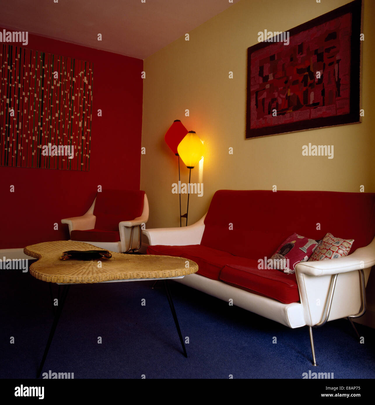 Red Cushions On White Leather Fifties Sofa In Living Room With Stock Photo Alamy