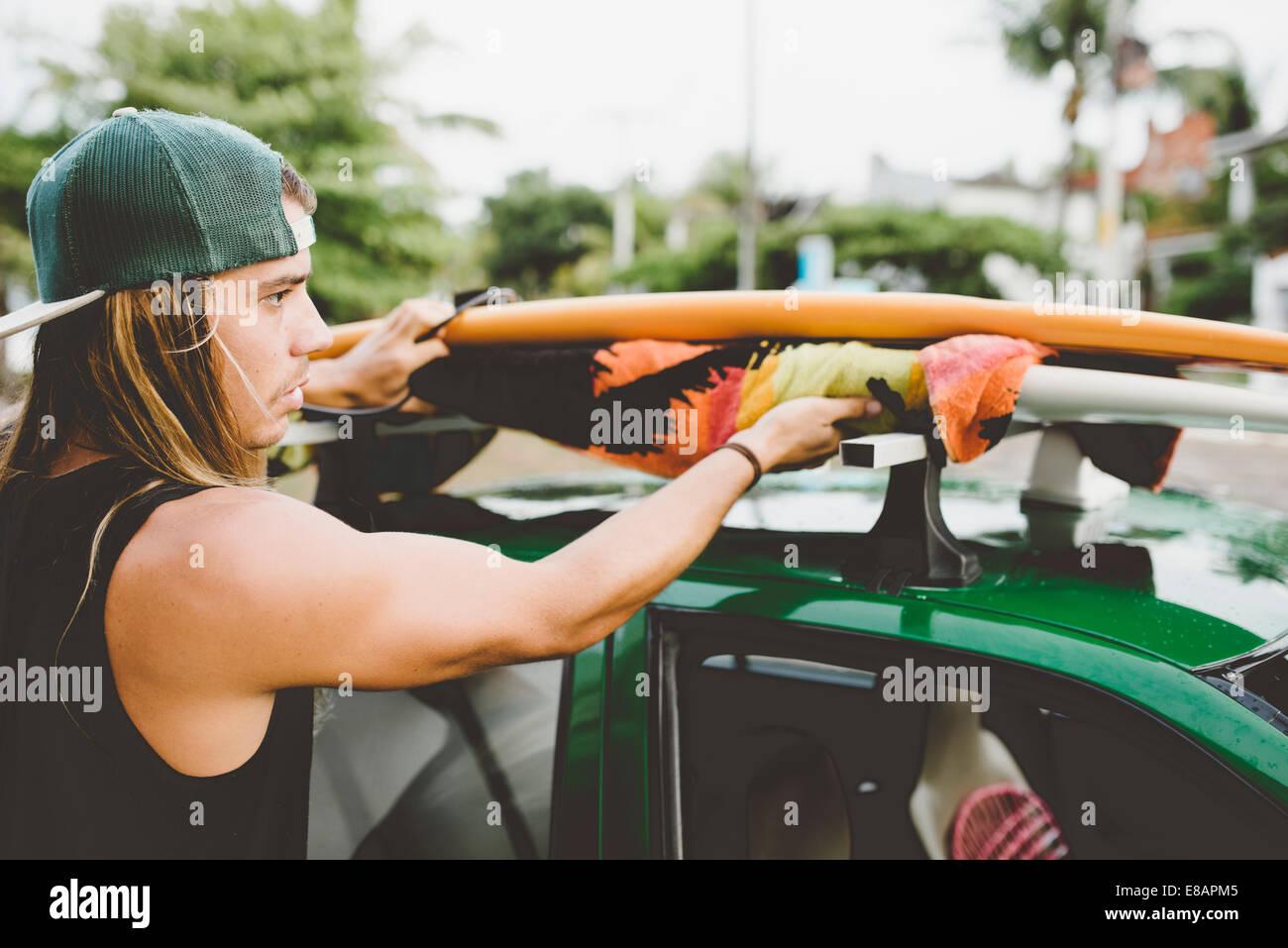 Australian surfer preparing for trip - Stock Image