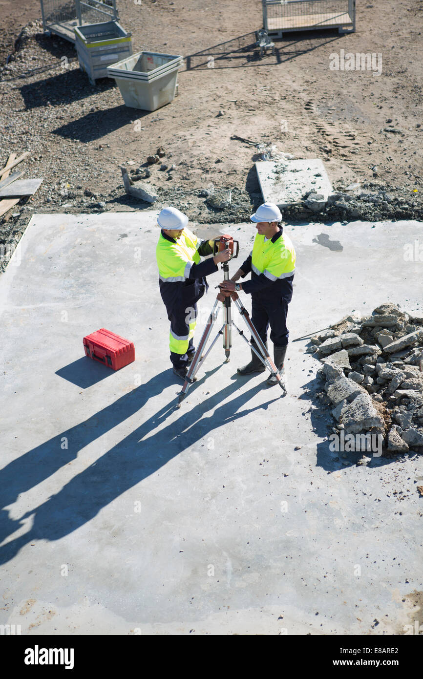 High angle view of site manager and surveyor on construction site - Stock Image