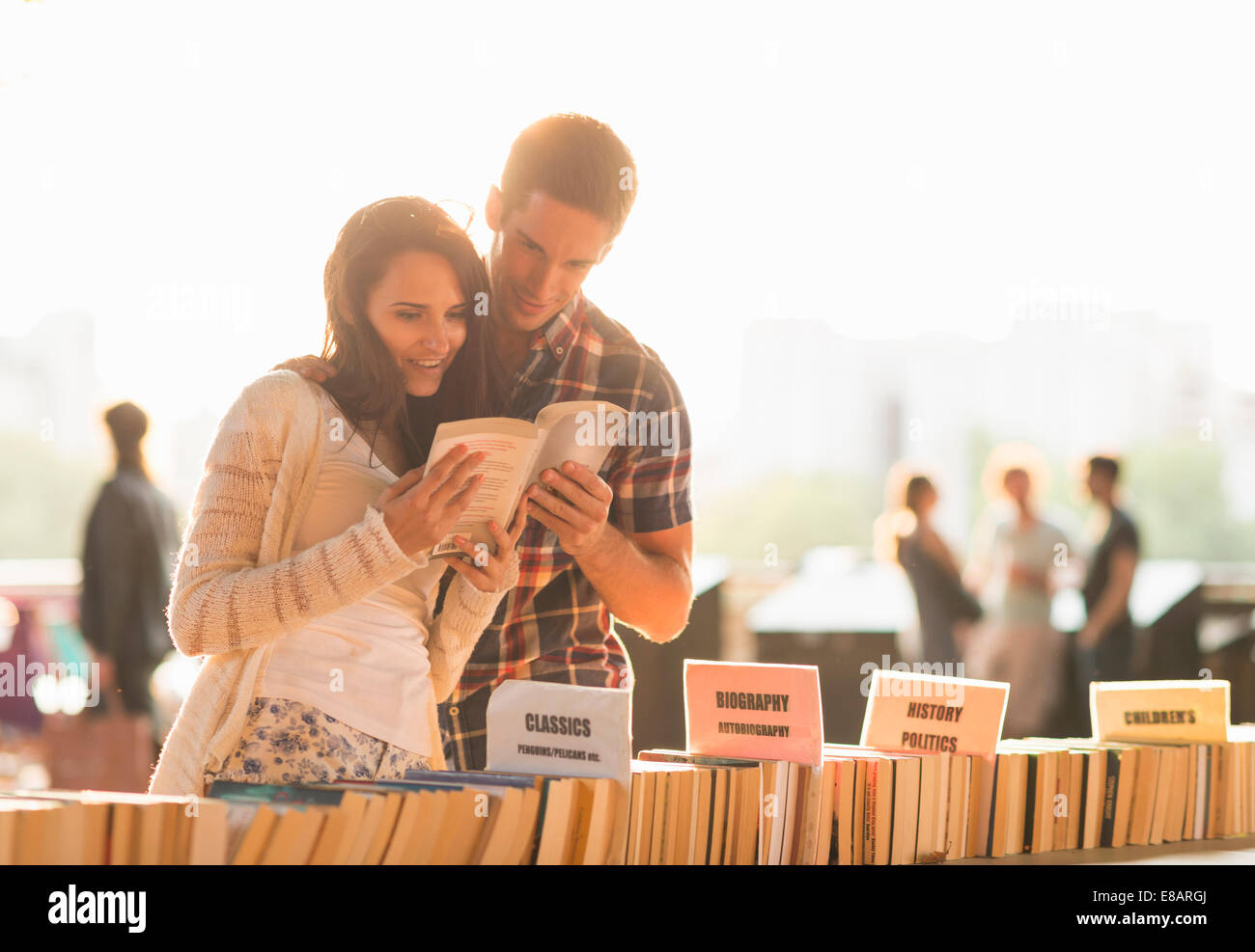 Young couple at second hand book stall - Stock Image