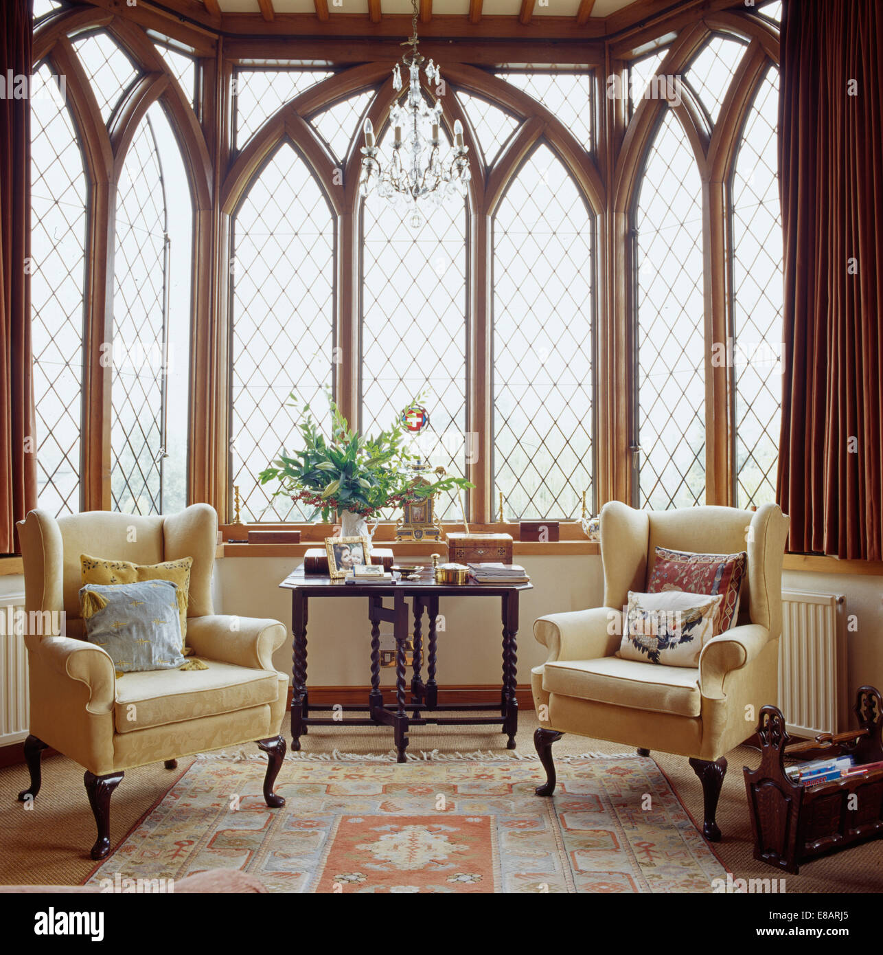 Cream Wing Back Chairs In Front Of Tall Gothic Style Windows In Country  Living Room With Antique Silk Carpet
