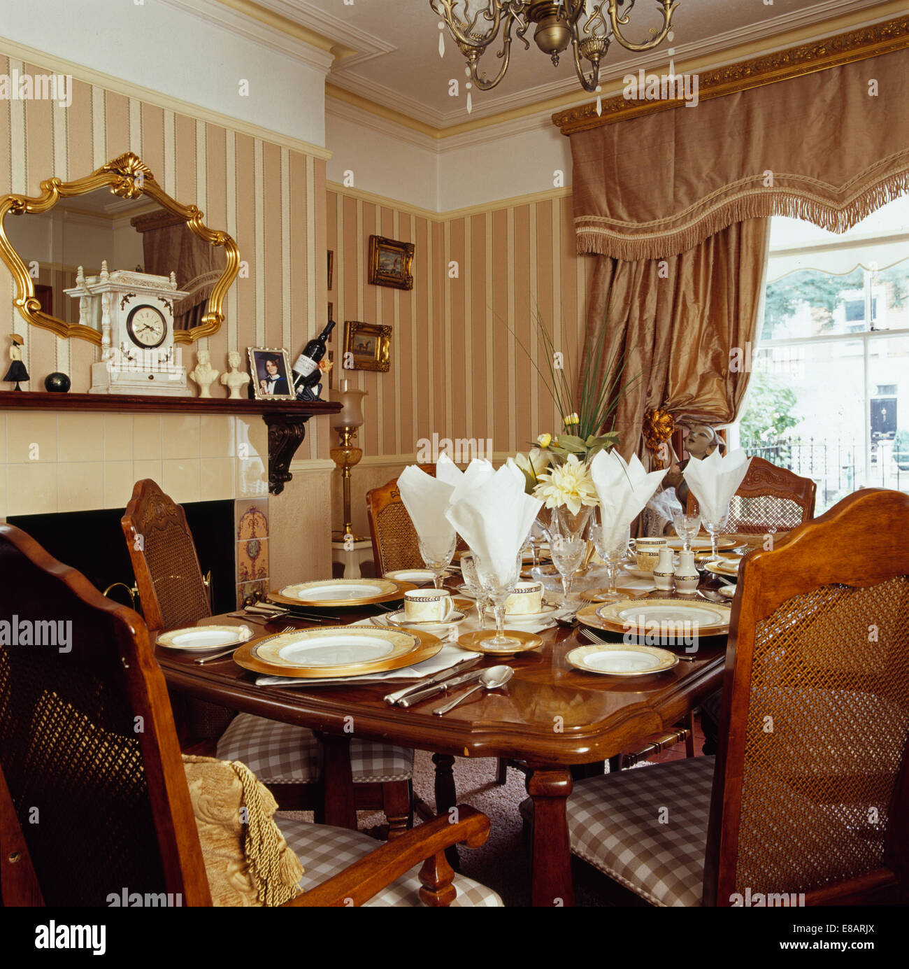 Antique Mahogany Table Set For Lunch In Dining Room With Striped Wallpaper  And Heavy Beige Silk Curtains