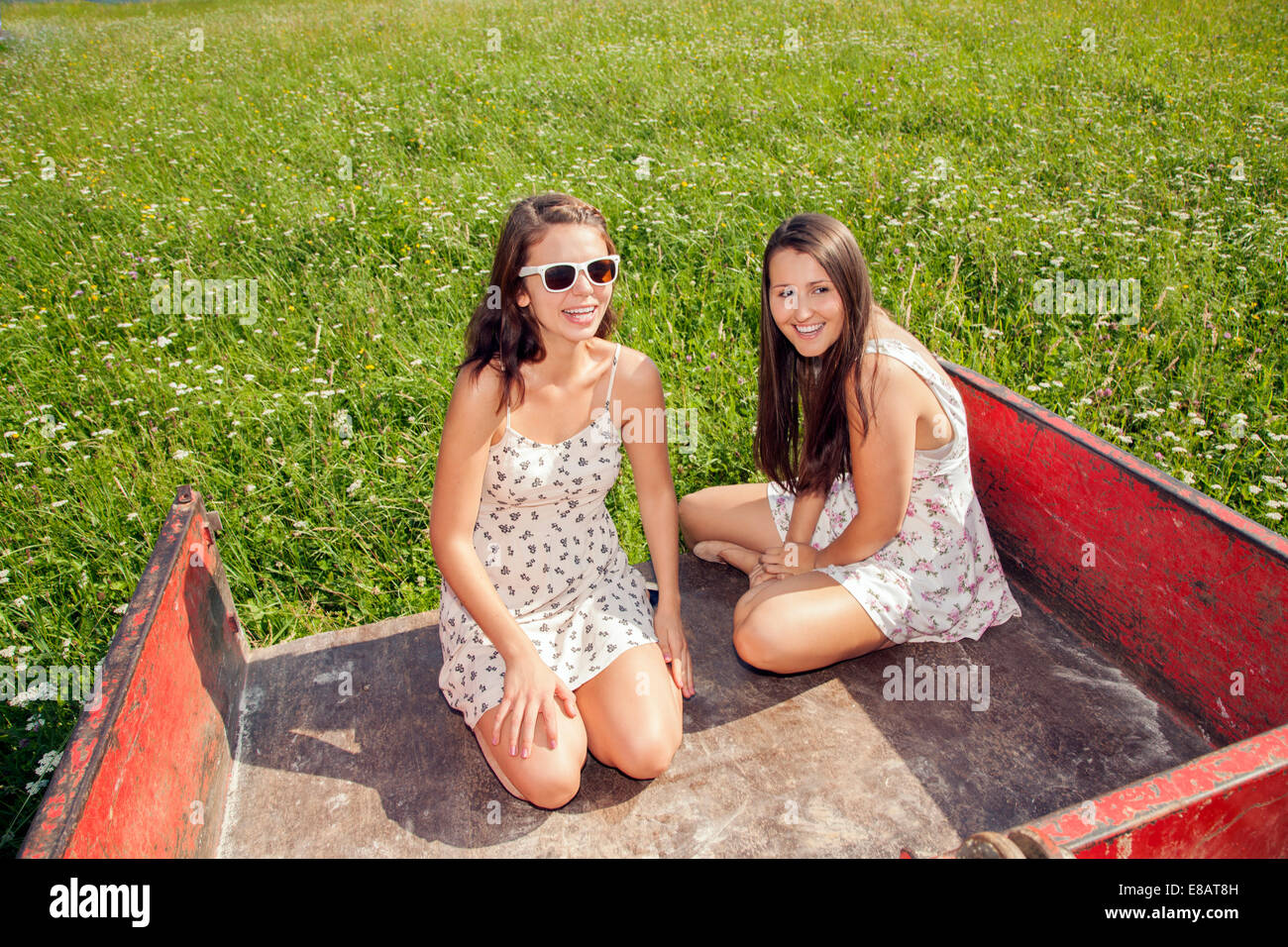 Young women sitting in trailer - Stock Image