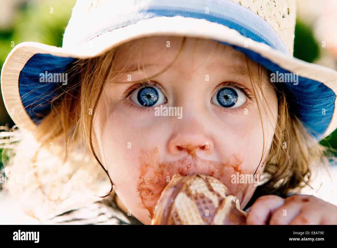 Young girl eating ice cream cone - Stock Image