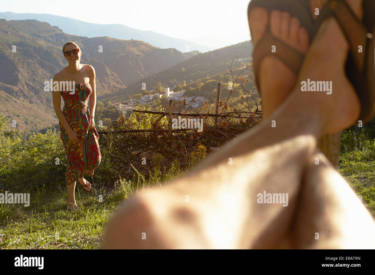 Young woman and selfie of mans legs, Sierra Nevada, Andalucia Granada, Spain - Stock Image