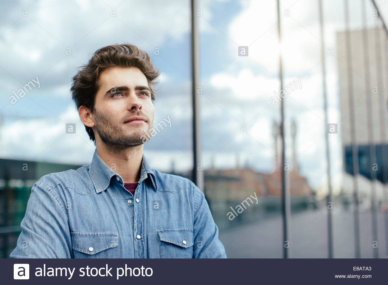 Young man by window - Stock Image