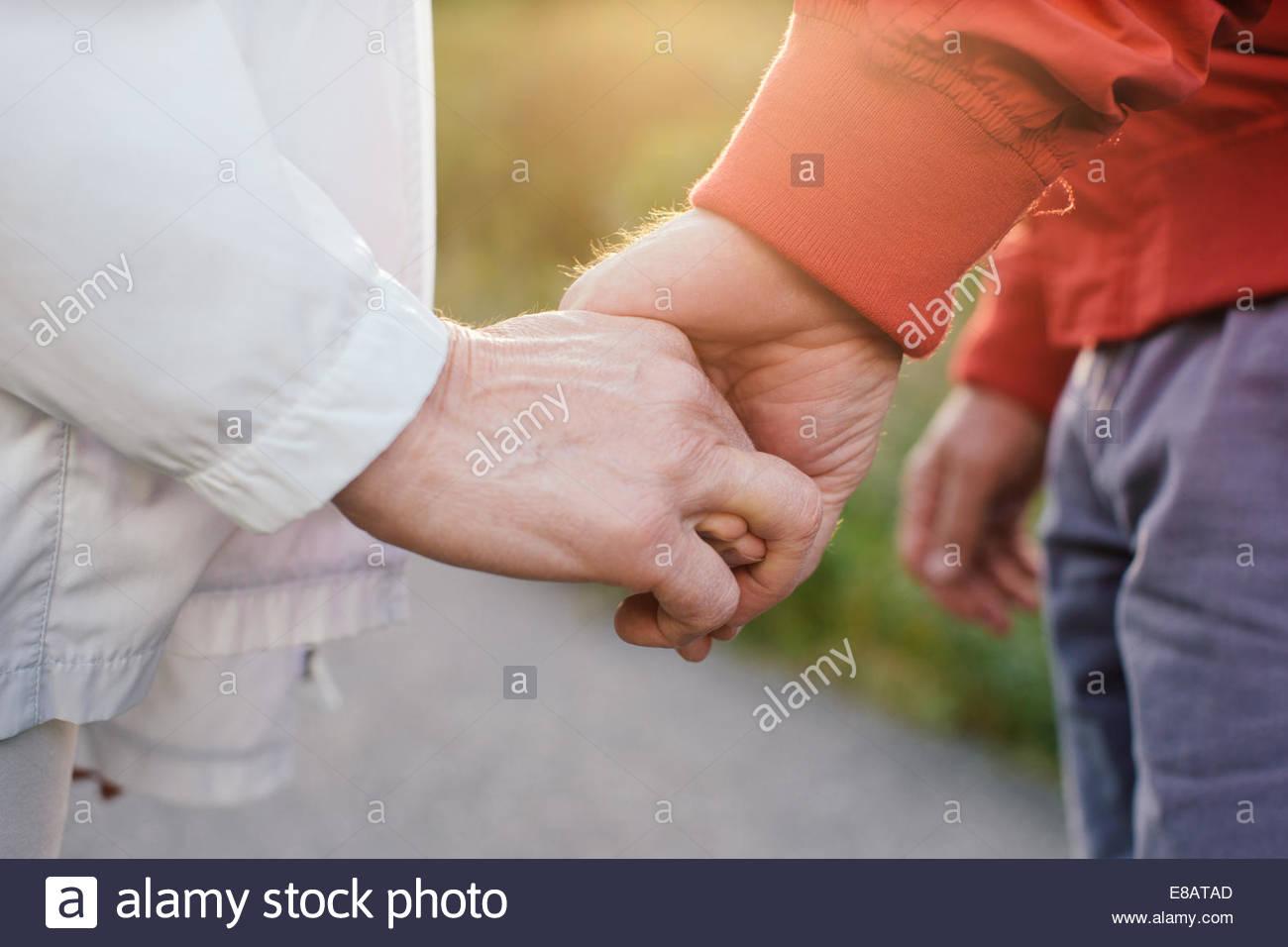 Senior couple holding hands, close up - Stock Image