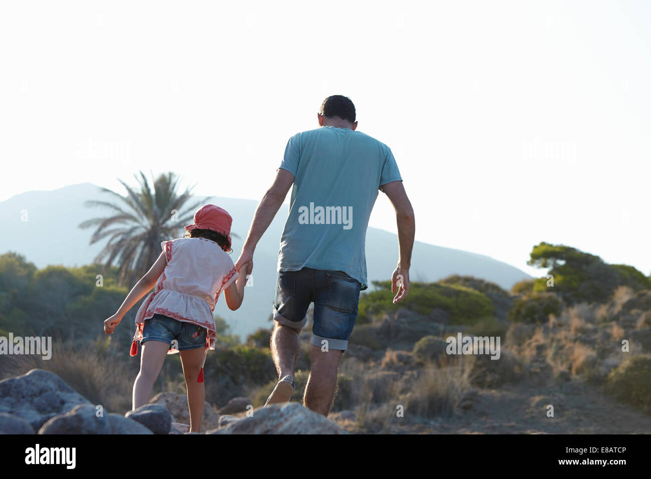 Father and daughter walking in hills hand in hand, Almeria, Andalusia, Spain - Stock Image