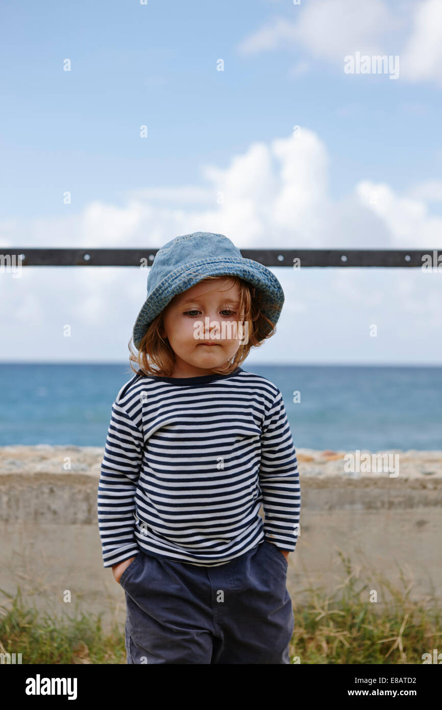 Young girl wearing hat and striped top - Stock Image