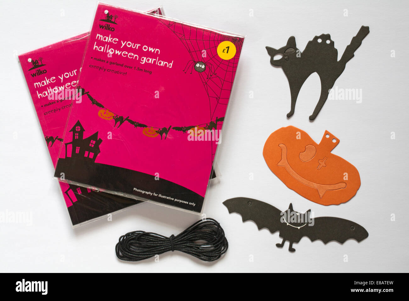 Wilko make your own halloween garland with black cats. bats, pumpkins and cord isolated on white background - Stock Image