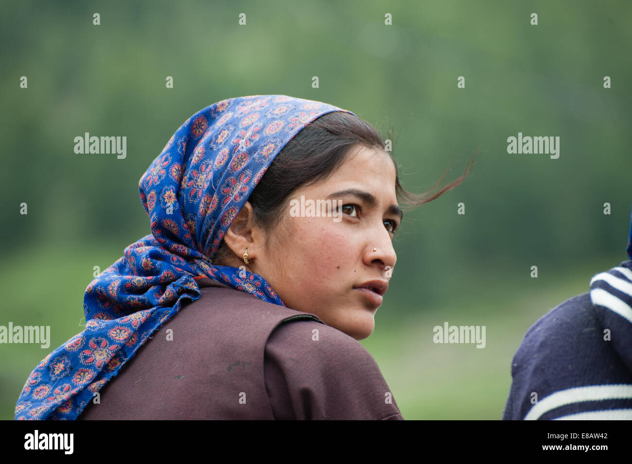 young village Girl is ooking back - Stock Image