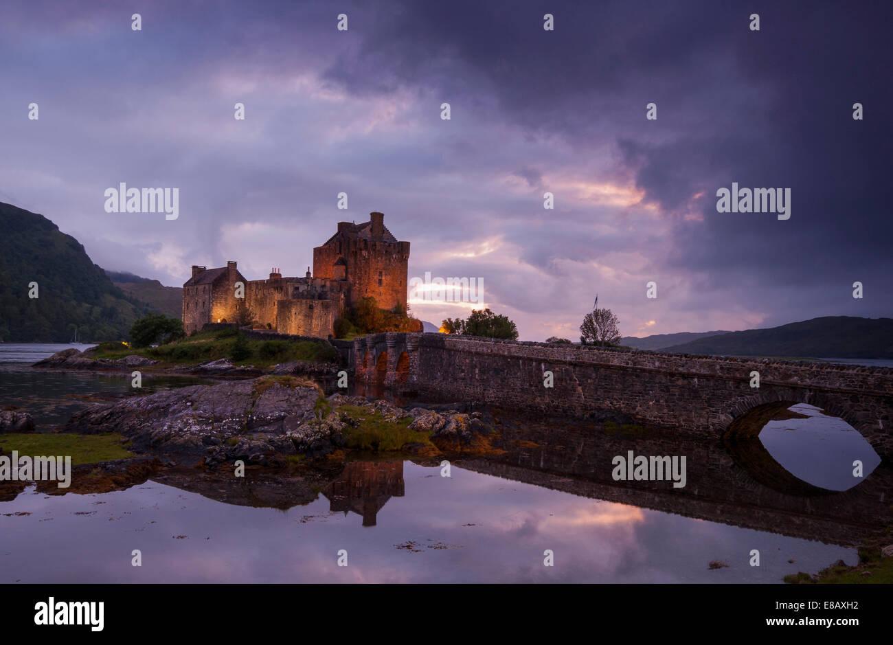 Sunset at Eilean Donan Castle on Loch Duich near Dornie in Scotland, UK - Stock Image