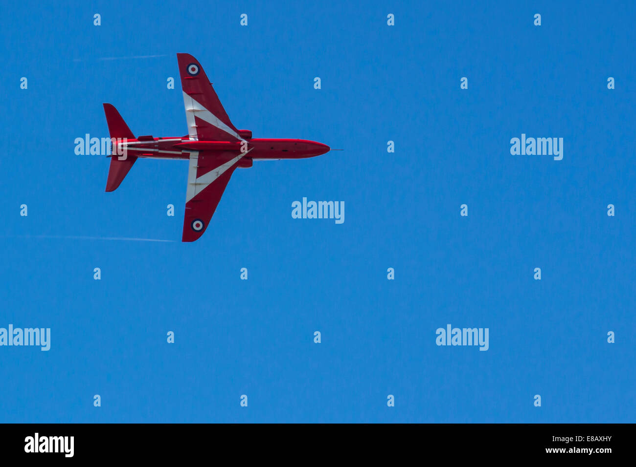 The Red Arrows perform against a clear blue sky at the Bournemouth Air Festival 2014. - Stock Image