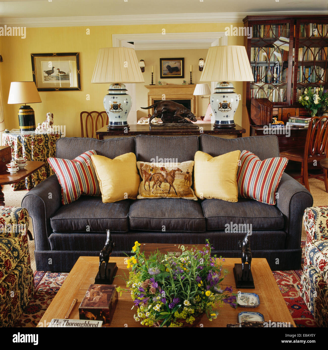 Pale Yellow And Striped Cushions On Dark Grey Sofa In Yellow Country