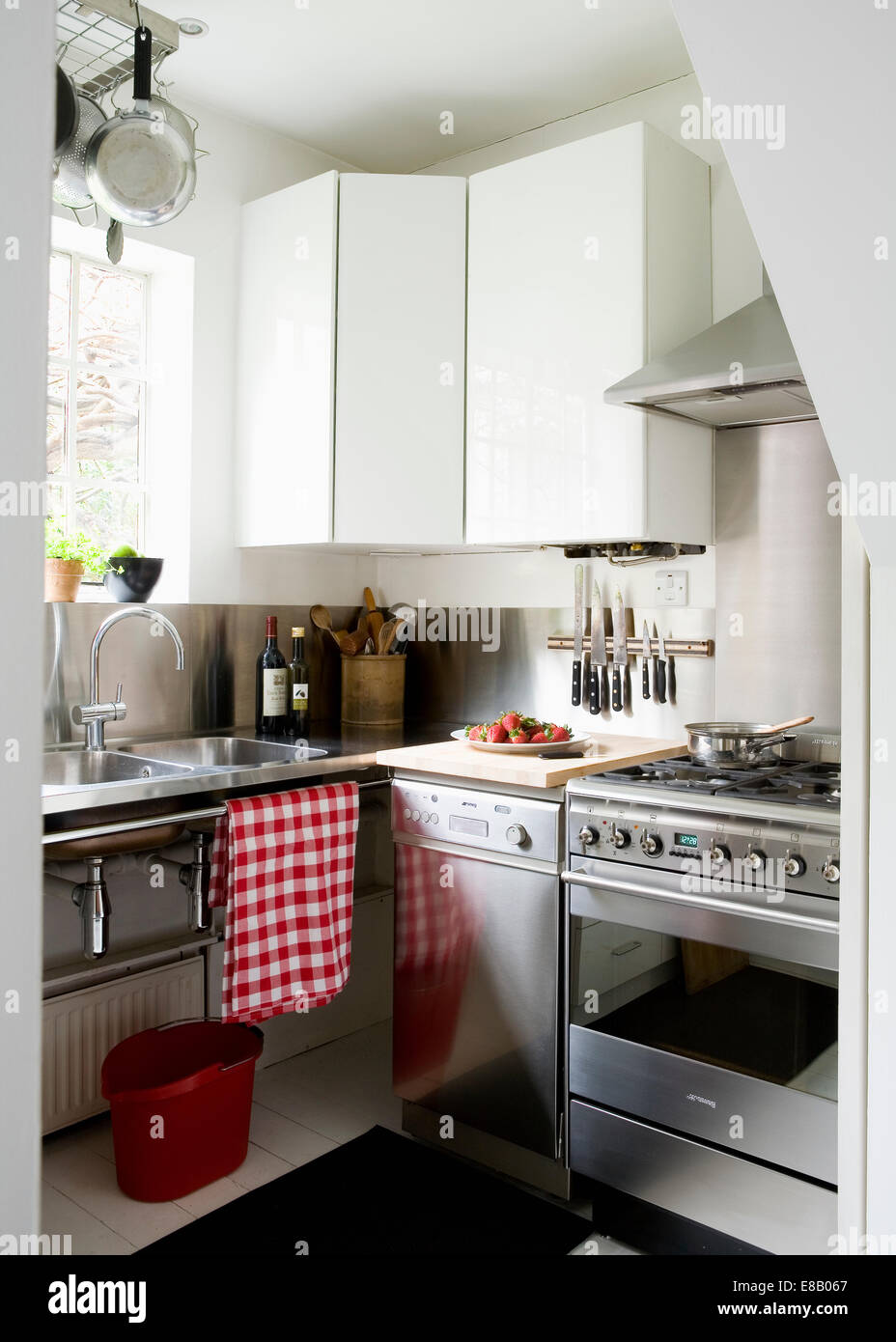 Small Stainless Steel Dishwasher Beside Stainless Steel Range Oven In  Modern White Urban Kitchen