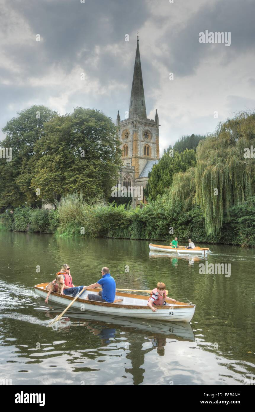 Holy Trinity Church and river stratford upon avon  rowing on river avon - Stock Image