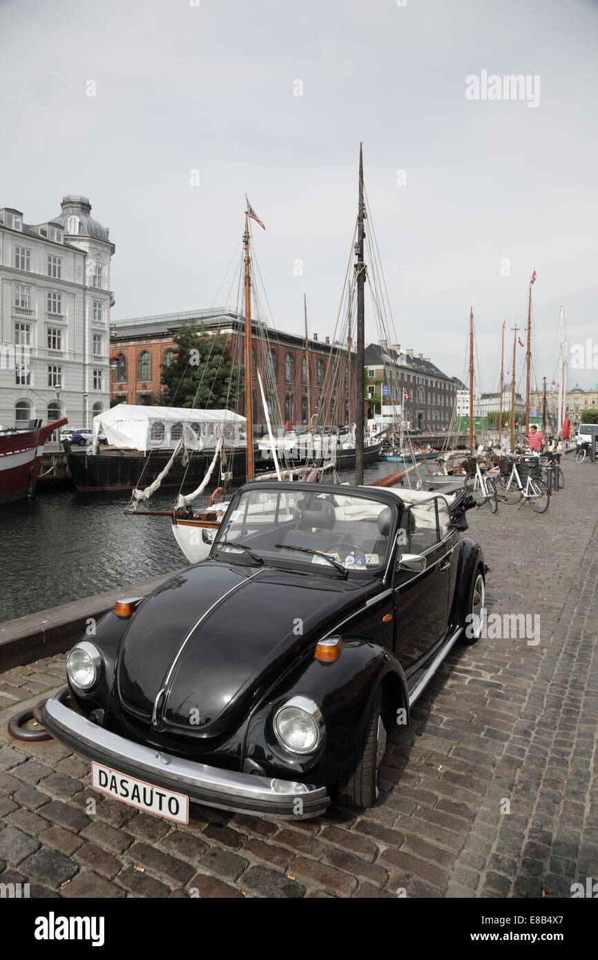"A classic black Volkswagen Beetle car in Nyhavn, Copenhagen, Denmark. Unique registration plate ""DAS AUTO"" Stock Photo"