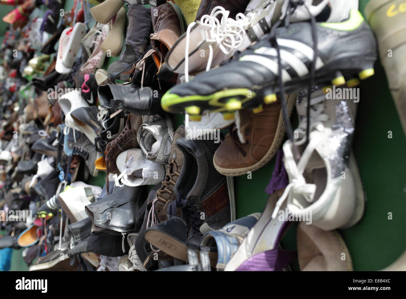 Collection of a Variety of Shoes Hanging on a Wall - Stock Image