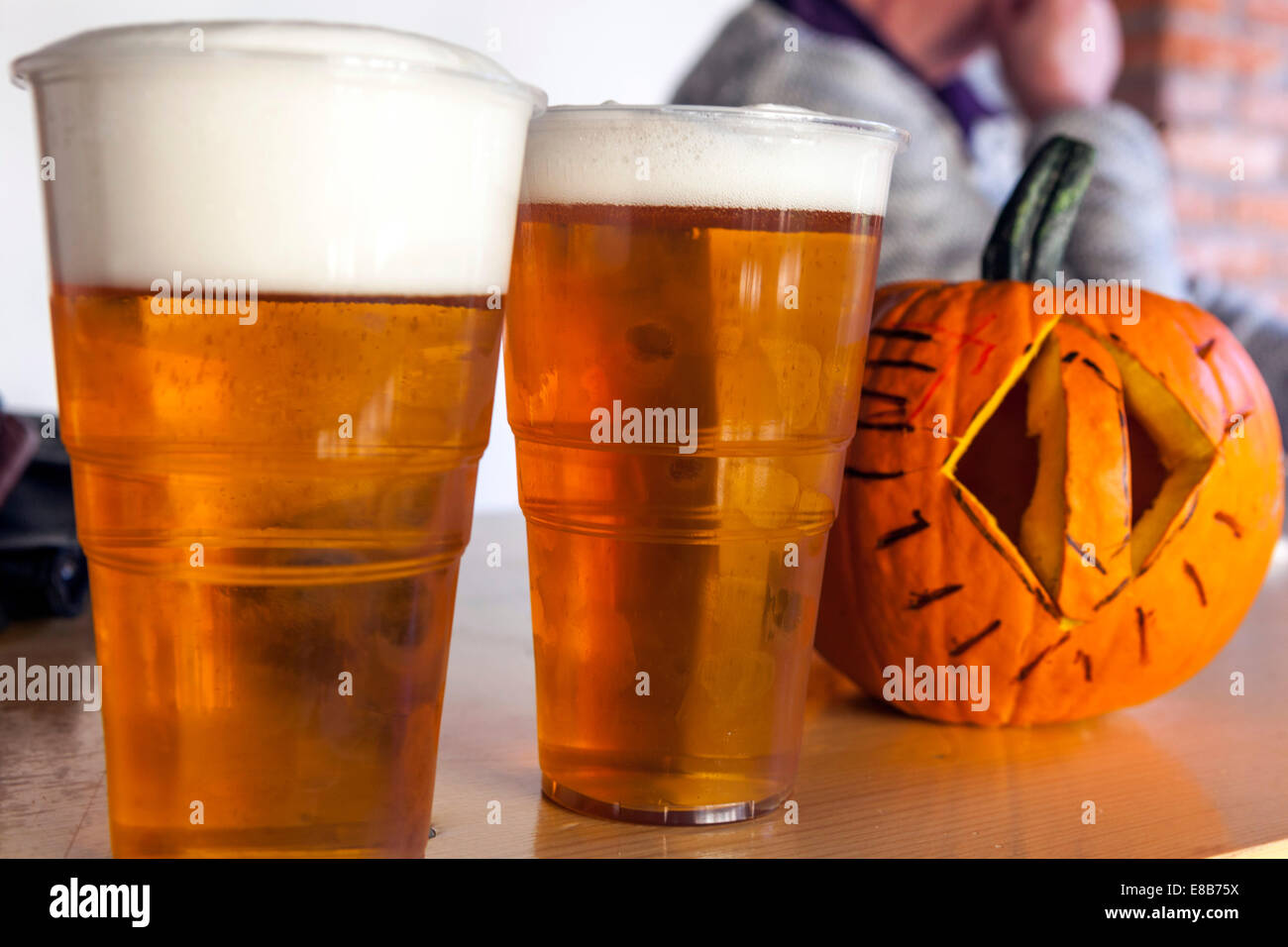 freshly tapped beer with foam and a carved pumpkin. Czech Republic - Stock Image