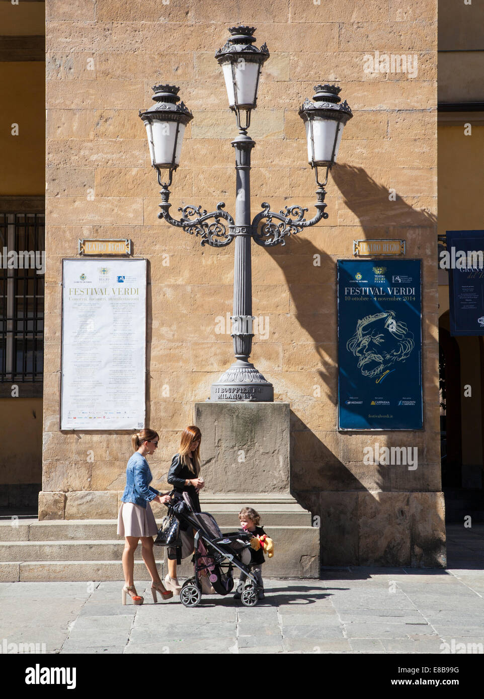 Two women with child and pushchair, Parma, Emilia-Romagna, Italy - Stock Image